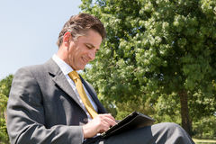 Businessman with tablet Royalty Free Stock Photos