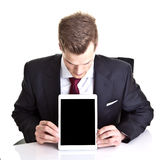 Businessman with a tablet Royalty Free Stock Photo