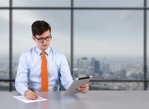 Businessman with tablet Royalty Free Stock Photo