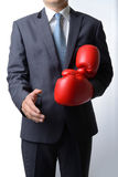 Businessman take off boxing gloves to offer a handshake on white Stock Photos