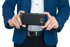 Businessman take a photo with smart phone. Isolate royalty free stock photography