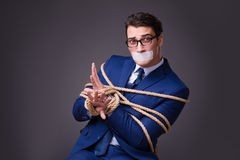 The businessman taken hostage and tied up with rope Royalty Free Stock Photo