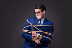 The businessman taken hostage and tied up with rope Royalty Free Stock Photography