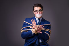 The businessman taken hostage and tied up with rope Royalty Free Stock Images