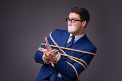 The businessman taken hostage and tied up with rope Royalty Free Stock Photos