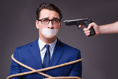 The businessman taken hostage and tied up with rope Stock Photography