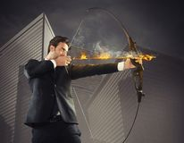 Businessman takes aim Stock Images