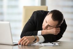 Businessman takes break and dozing in office Royalty Free Stock Photos