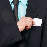 Businessman takes out business card Royalty Free Stock Images