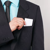 Businessman takes out business card Stock Images