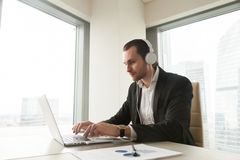 Businessman takes part in online conference stock image