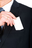 Businessman taking a blank card from pocket Stock Photography