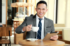 Businessman taking a break at coffee shop Royalty Free Stock Photography