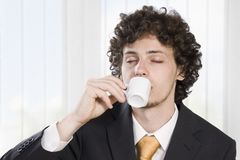 Businessman taking a break with a cup of coffee Royalty Free Stock Image
