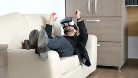 Businessman is taking a break in his office using the VR headset technology stock footage