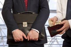 Businessman taking bribe Stock Photos