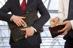 Businessman taking bribe Stock Photos