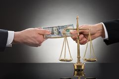 Businessman taking bribe in front of justice scale Royalty Free Stock Photography