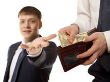 Businessman taking bribe over white background. Stock Photo
