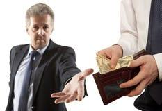 Businessman taking bribe over white background. Royalty Free Stock Photo