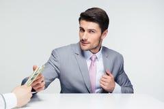 Businessman taking bribe Royalty Free Stock Photos