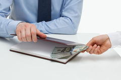 Businessman taking a bribe Stock Images