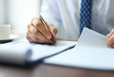 Businessman taking business notes Stock Photography
