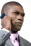 Businessman taking a call. A young African-American businessman looks confident as he taks a call on his mobile phone Stock Photos