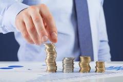 Businessman taking coin Royalty Free Stock Photos