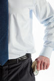 Businessman taking dollars out of a pocket Royalty Free Stock Images