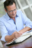 Businessman taking down notes Royalty Free Stock Image