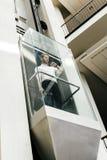Businessman taking the elevator Stock Image
