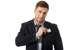 Businessman taking his personal card. Royalty Free Stock Photos