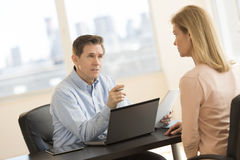 Businessman Taking Interview Of Female Candidate Stock Photos