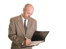Businessman taking notes Stock Photo