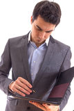 Businessman taking notes. Young businessman taking notes. Isolated on white Royalty Free Stock Photo