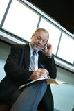 Businessman taking notes Stock Photography