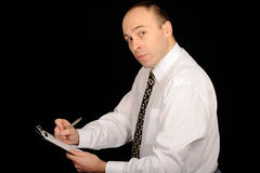 Businessman taking notes Royalty Free Stock Photography
