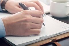 Businessman taking notes Stock Photo