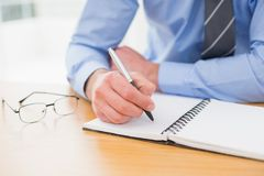 Businessman taking notes on notebook Royalty Free Stock Image