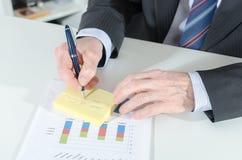 Businessman taking notes Stock Photos