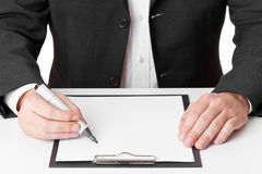 Businessman taking notes Royalty Free Stock Photos