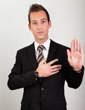 Businessman Taking Oath. Success Man With Arm On Chest Taking Oath Royalty Free Stock Photography
