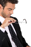 Businessman taking off his glasses Stock Photography