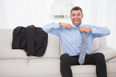 Businessman taking off his tie Royalty Free Stock Image
