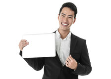Businessman taking out his laptop Royalty Free Stock Image