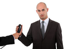 Businessman taking a phone call. From his boss Stock Image
