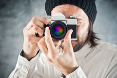 Businessman taking photo with vintage film camera Royalty Free Stock Photo
