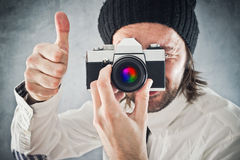 Businessman taking photo with vintage film camera Stock Photography