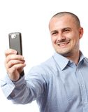 Businessman taking photos with cellphone Royalty Free Stock Photo